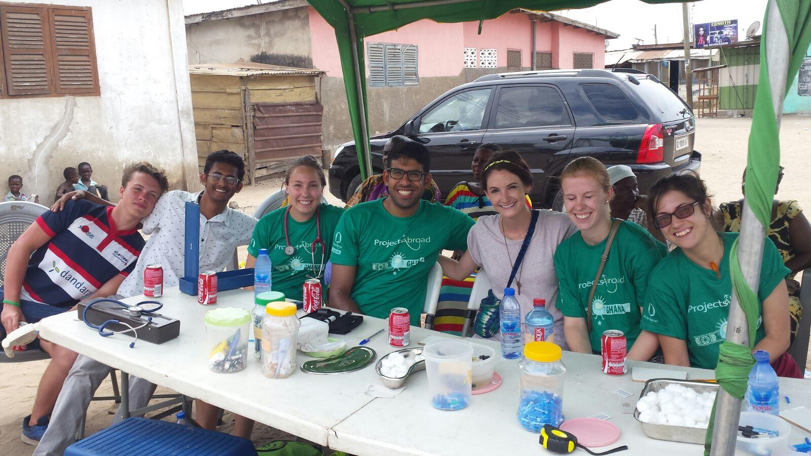 A group of interns from Projects Abroad are pictured being briefed on their tasks whilst on a public health internship in Ghana.